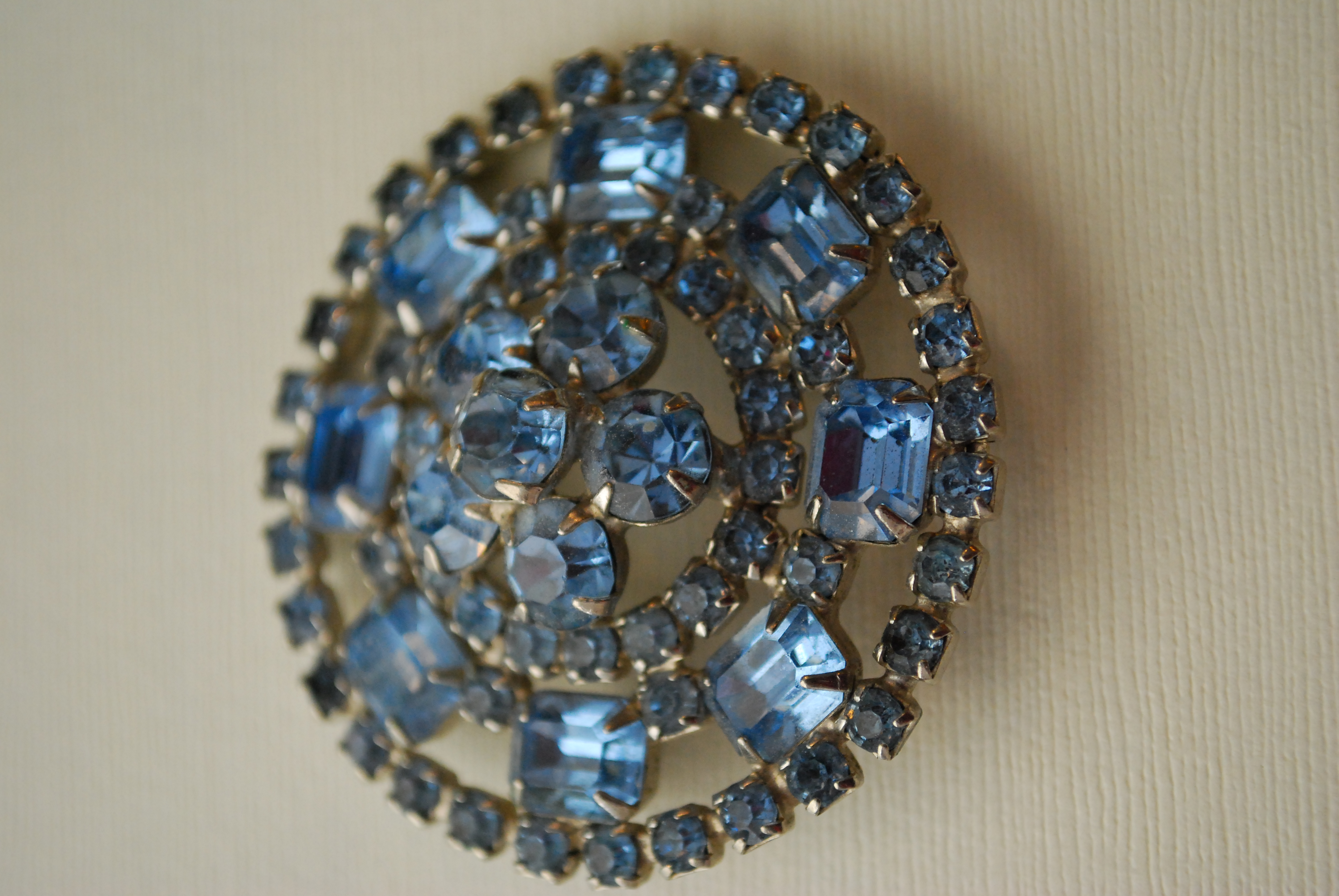 Close-up of a broach with blue gemstones decorating it