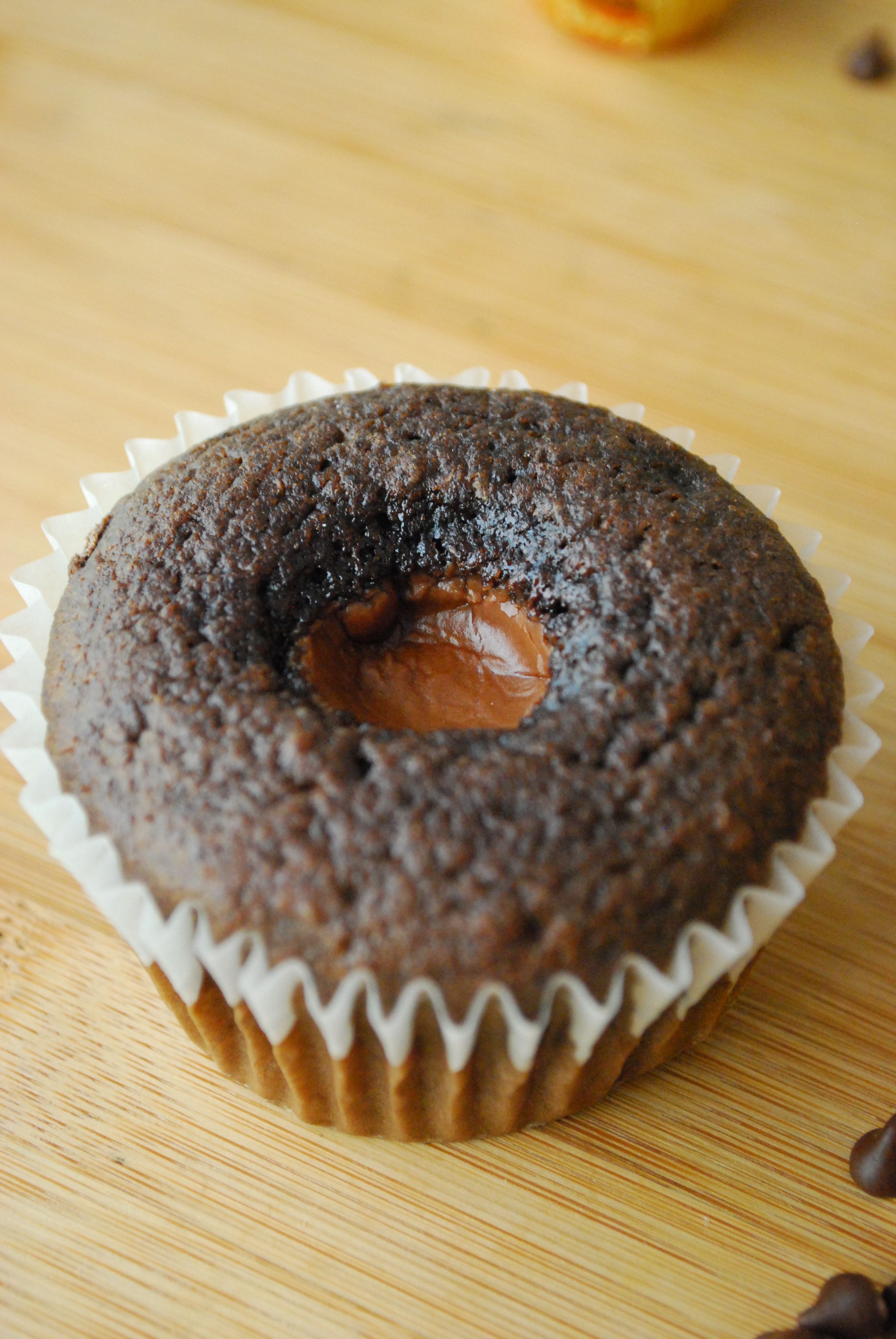 Chocolate peanut butter cupcake without frosting to show the peanut butter inside